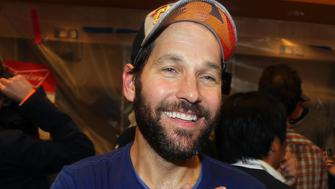 NEW YORK, NY - NOVEMBER 1:  Actor Paul Rudd celebrates in the locker room with the Kansas City Royals after a 7-2 victory in Game 5 of the 2015 World Series over the New York Mets at Citi Field on Sunday, November 1, 2015 in the Queens borough of New York City. (Photo by Brad Mangin/MLB Photos via Getty Images)