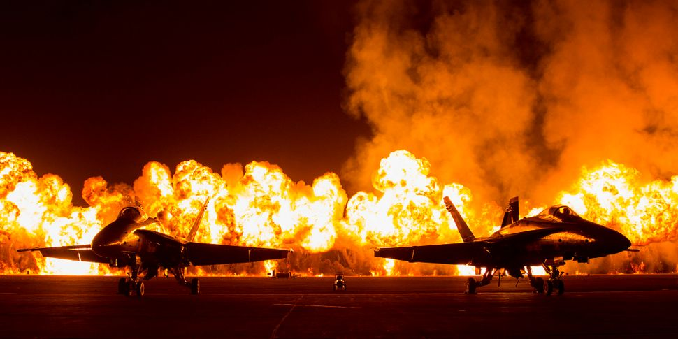 Two FA-18 Jets are displayed in front of the Wall of Fire during the Marine Corps Community Services sponsored 2015 Air Show