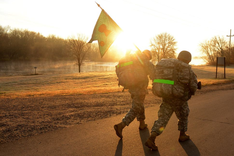 U.S. Army officer candidates, from the Minnesota National Guard Officer Candidate School, conduct a 10-mile ruck march at Cam
