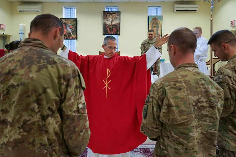 U.S. Army Chaplain Paul Hurley, a Catholic priest, says Mass for the troops at a military base in Kabul, Afghanistan.