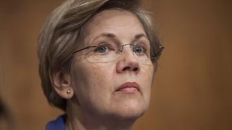 WASHINGTON, USA - JULY 16: Senator Elizabeth Warren listens to Janet Yellen's testimony during a Senate Banking, Housing, and Urban Affairs Committee during a hearing on The Semiannual Monetary Policy Report to the Congress. in Washington, USA on JULY 16, 2015. (Photo by Samuel Corum/Anadolu Agency/Getty Images)