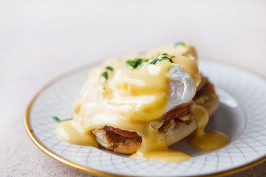 """<strong>Get the <a href=""""http://www.simplyrecipes.com/recipes/eggs_benedict/"""">Eggs Benedict recipe </a>from Simply Recipes</s"""