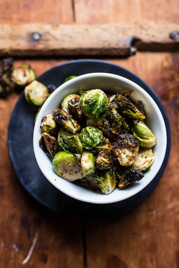 "<strong>Get the <a href=""http://www.halfbakedharvest.com/30-minute-chicken-ramen-with-miso-roasted-brussels-sprouts-ginger-bu"