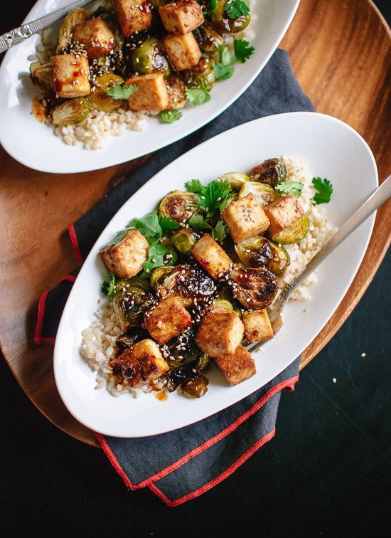 "<strong>Get the <a href=""http://cookieandkate.com/2014/roasted-brussels-sprouts-and-crispy-baked-tofu-with-honey-sesame-glaze"
