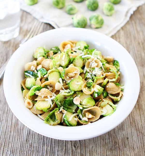 "<strong>Get the <a href=""http://www.twopeasandtheirpod.com/brown-butter-brussels-sprouts-pasta-with-hazelnuts/"" target=""_blan"
