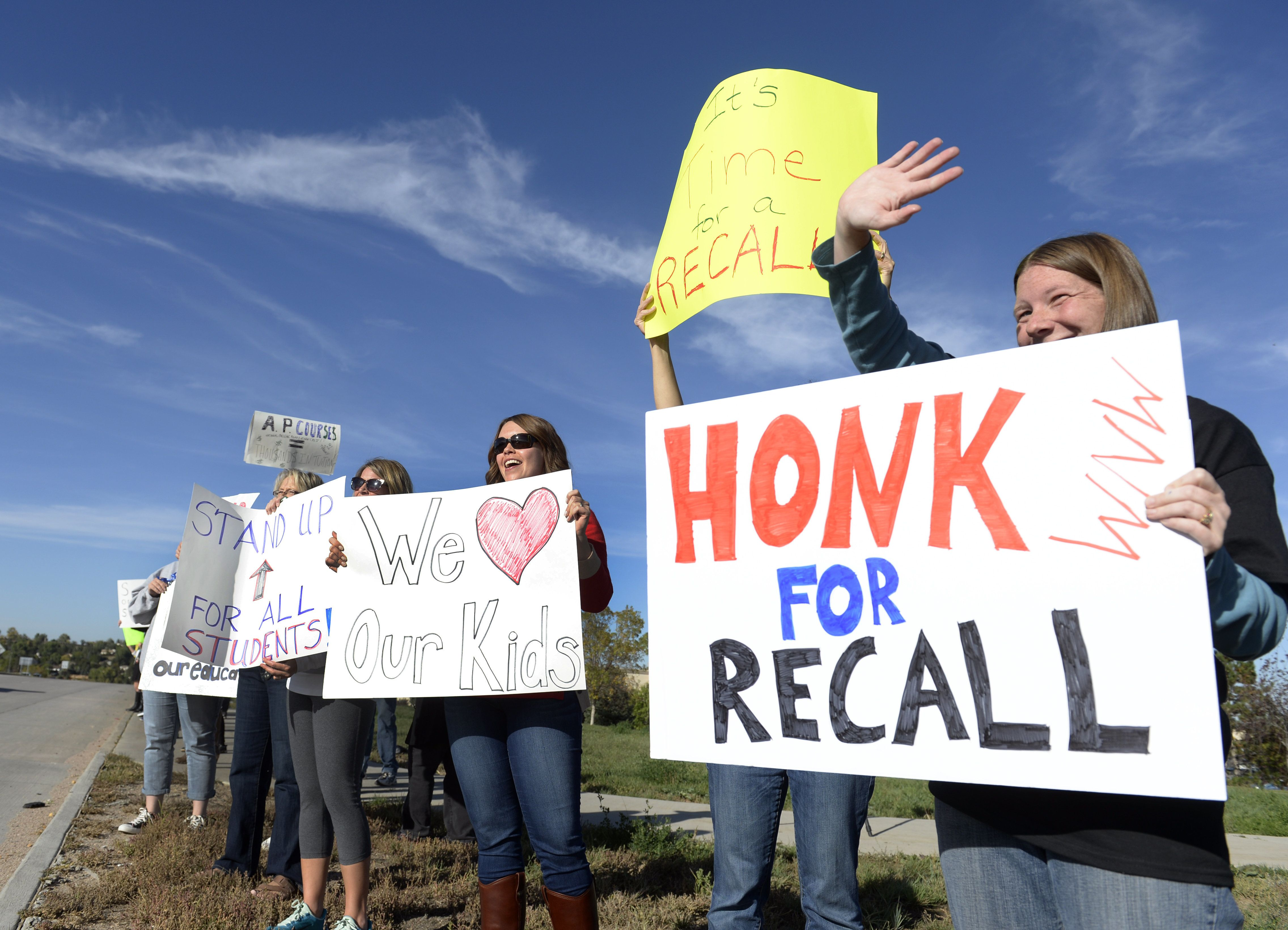 LITTLETON, CO - OCTOBER 3: Ann Hampton, right, stands with fellow students, teachers, and parents from both Jefferson County and Douglas County as they join an event dubbed 'Boots on the Boulevard' and stand on the corner of S. Wadsworth Blvd. and W. Chatfield Ave. in Littleton to in protest against the Jefferson County school board. (Kathryn Scott Osler/The Denver Post via Getty Images)