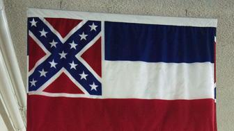 The Mississippi state flag hangs in an underground hallway at the US Capitol in Washington, DC on June 23, 2015. As South Carolina governor Nikki Haley gave the press conference in which she called for the Confederate flag to be removed from South Carolina's capitol building, lawmakers and activists in other states pressed for similar changes in their respective districts. AFP PHOTO/PAUL J. RICHARDS        (Photo credit should read PAUL J. RICHARDS/AFP/Getty Images)