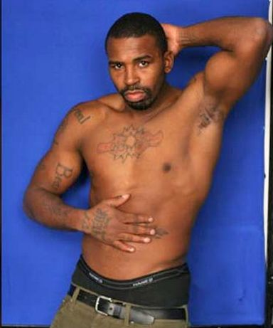 "<span class='image-component__caption' itemprop=""caption"">Boxer Yusaf Mack, 35, has come out as bisexual after admitting he appeared in a gay porn film.</span>"