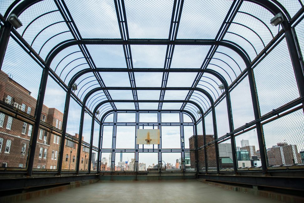 A basketball court on top of the building, from which incarcerated women could see the hustle and bustle of the city below th