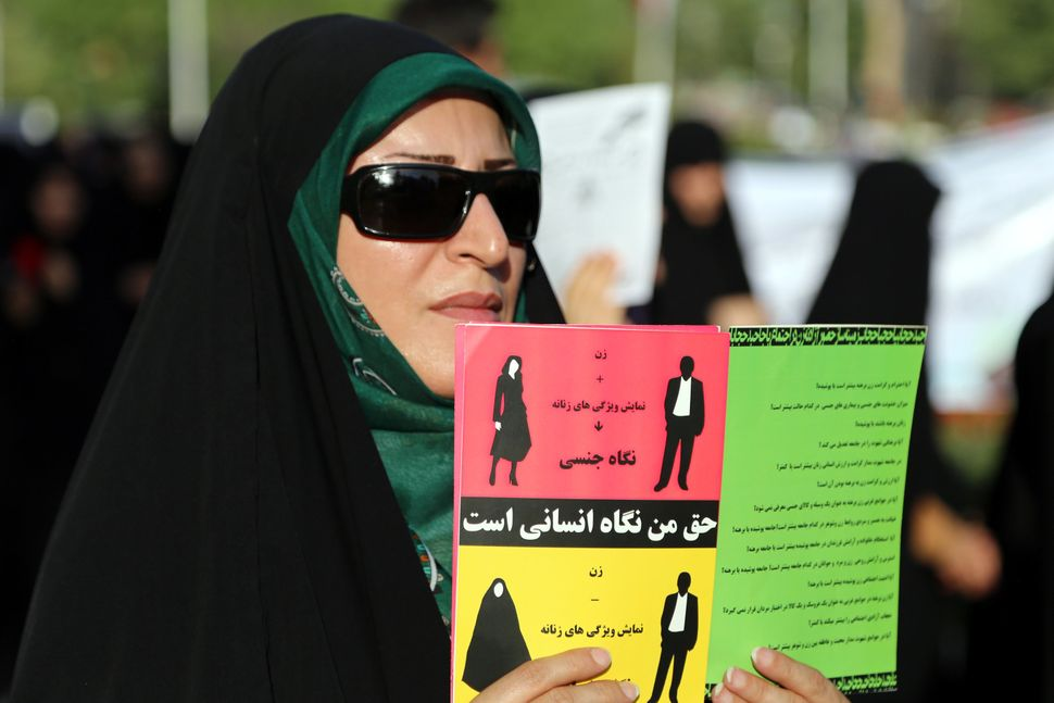 A woman protests hijab law on Hijab and Chastity National Day in Mashhad, Iran on July 12, 2014.