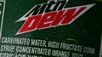 SAN FRANCISCO, CA - JUNE 10:  High fructose corn syrup is listed in the ingredients of a bottle of Mountain Dew that is displayed in a cooler of a food truck on June 10, 2015 in San Francisco, California. The San Francisco board of supervisors has approved an ordinance that would require warning labels to be placed on advertisements for soda and sugary drinks to alert consumers of the risk of obesity, diabetes and tooth decay. The ordinance would also ban advertising of sugary drinks on city-owned property. If San Francisco mayor Ed Lee approves the  measure, the law would be the first of its kind in the nation.  (Photo by Justin Sullivan/Getty Images)