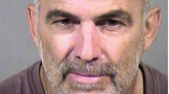 Paul Rater, 62, is accused of leaving his granddaughter in the desert with a loaded gun while he went to get a cheeseburger.