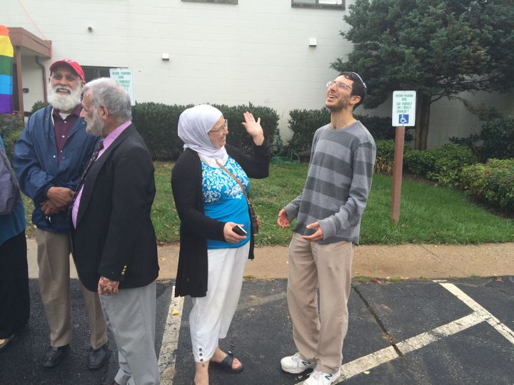 "Participants in the 2014 ""Spread Hummus Not Hate"" chat together during one of the bus' stops."