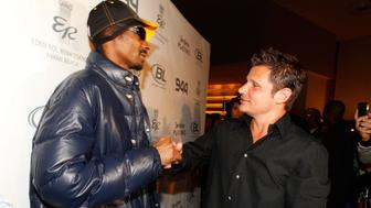 MIAMI BEACH, FL - FEBRUARY 04:  Rapper Snoop Dogg (L) and singer/TV personality Nick Lachey attend the Super Skins Kick Off Party at Hotel 944 featuring Snoop Dogg at The Eden Roc Renaissance Miami Beach on February 4, 2010 in Miami Beach, Florida.  (Photo by Christopher Polk/Getty Images)