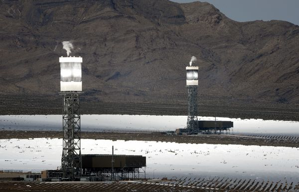 Two of the three units at the 392-megawatt Ivanpah Solar Electric Generating System are seen operating in the Mojave Desert i