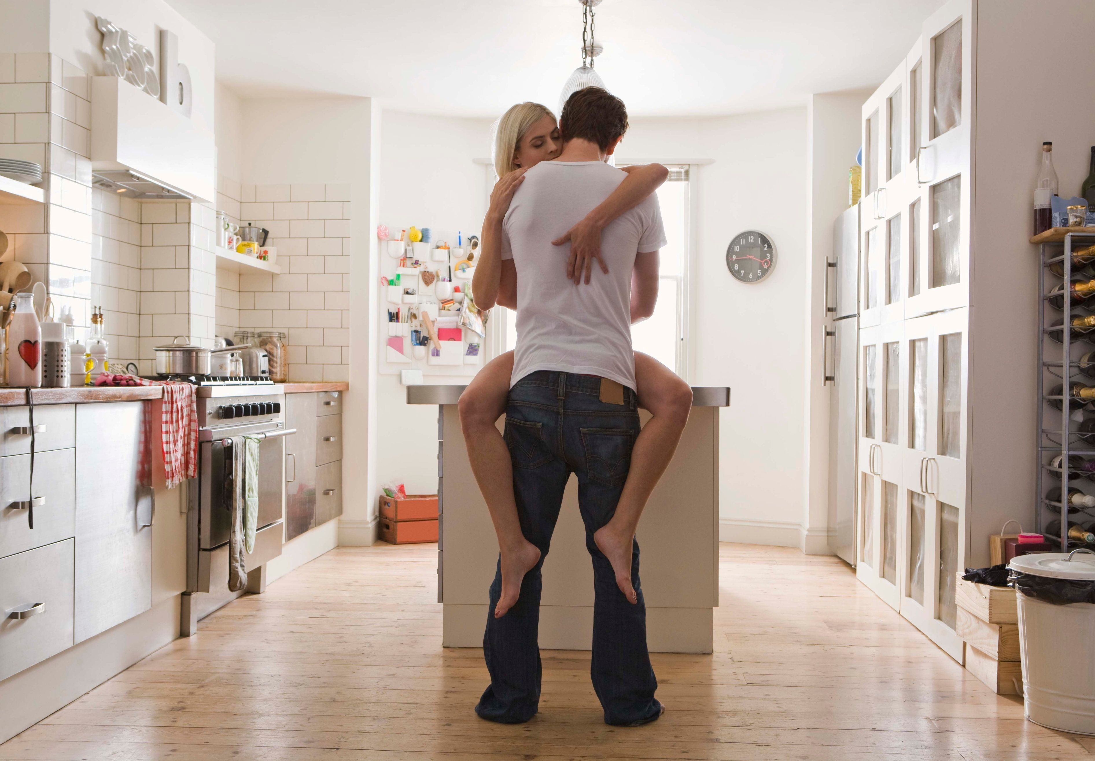Affectionate couple in kitchen