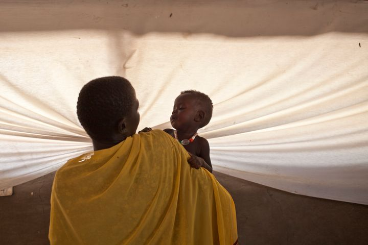 A mother holds her child in a hospital in Lankien, South Sudan.