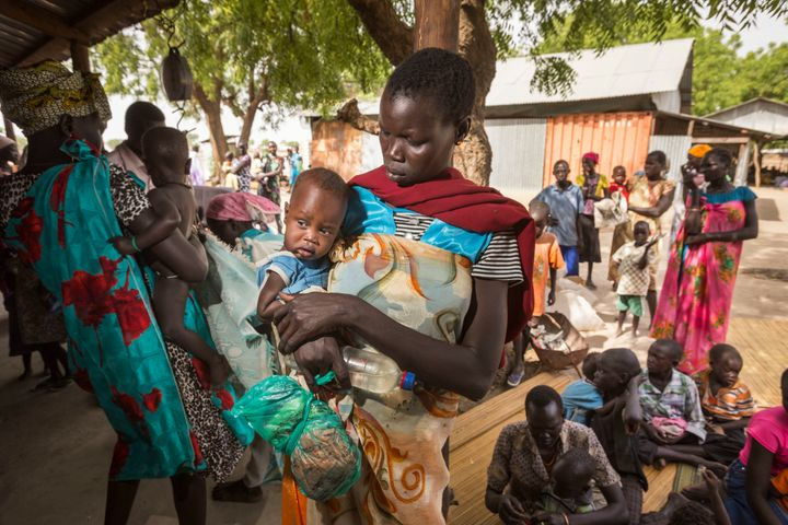 Nyagai Koang and her six-month-old baby Gawiech Keah Kuok wait for medical checks in Leer, South Sudan.