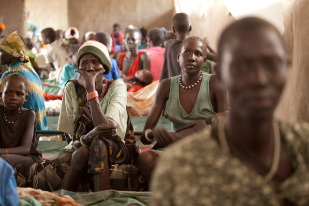 "<span class='image-component__caption' itemprop=""caption"">Families gather inside the therapeutic feeding center at the Doctors Without Borders Hospital in Lankien, South Sudan.</span>"