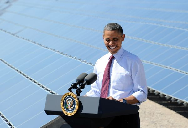 President Barack Obama smiles while speaking at Sempra U.S. Gas & Power's Copper Mountain Solar 1 facility in 2