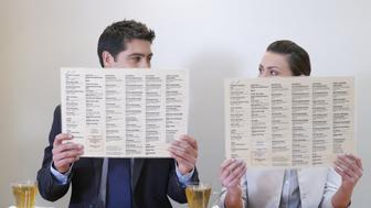 Man and woman with menus