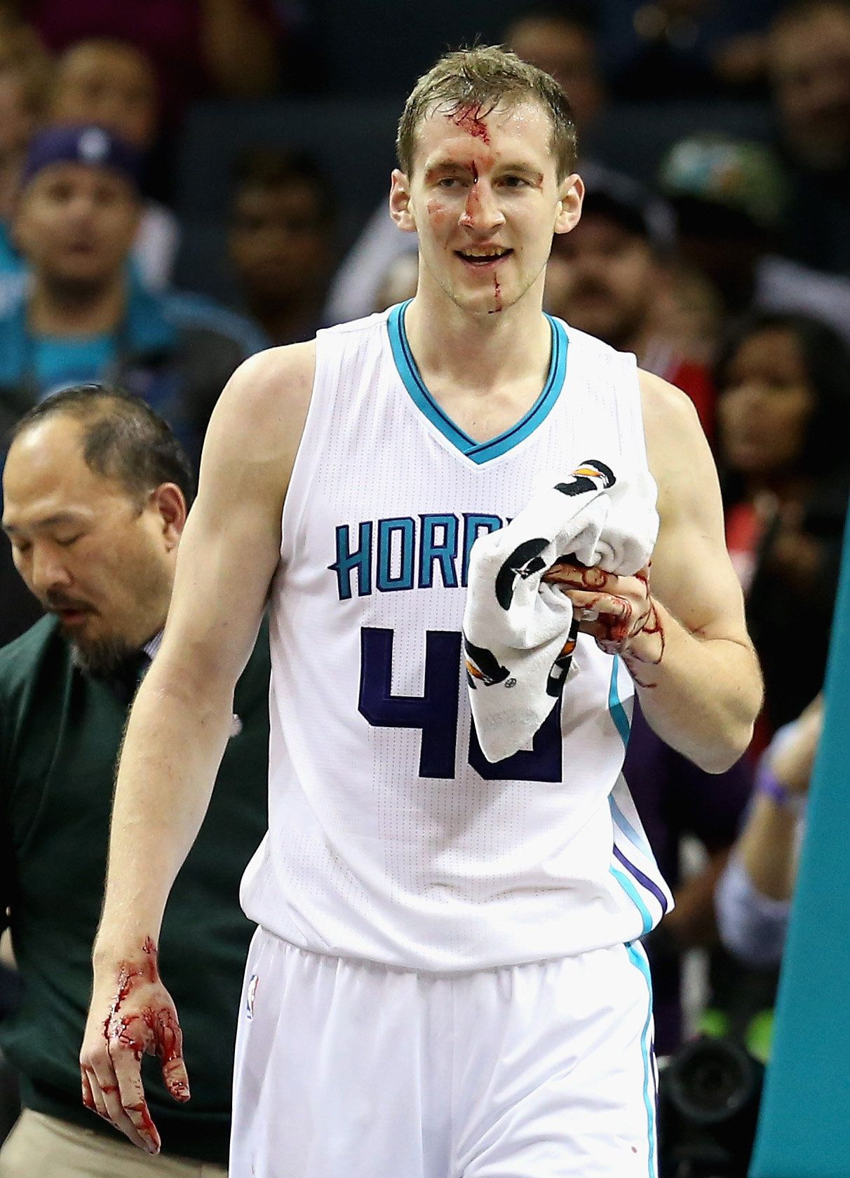CHARLOTTE, NC - NOVEMBER 03:  Cody Zeller #40 of the Charlotte Hornets is hit in the face by Joakim Noah #13 of the Chicago Bulls during their game at Time Warner Cable Arena on November 3, 2015 in Charlotte, North Carolina. NOTE TO USER: User expressly acknowledges and agrees that, by downloading and or using this photograph, User is consenting to the terms and conditions of the Getty Images License Agreement.  (Photo by Streeter Lecka/Getty Images)