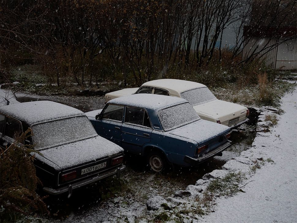 Snow-coated cars. Murmansk, Russia. October 2015.