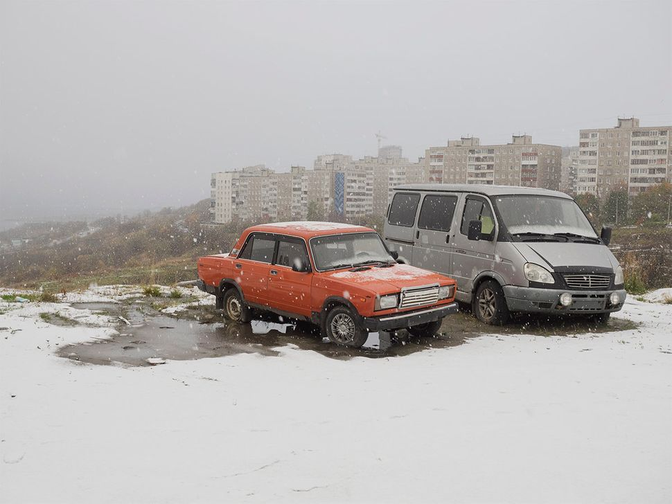 Cars in snow in Murmansk, Russia. October 2015.