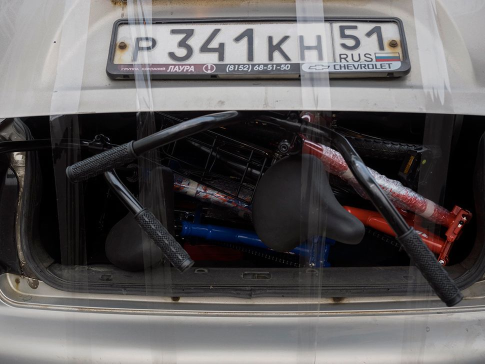 Bikes strapped to one of the black market taxis. Nickel, Russia. October 2015.