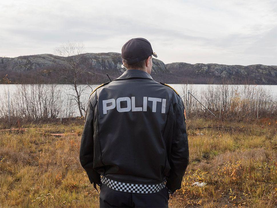 A policeman on the Norwegian border. Kirkenes, Norway. October 2015.