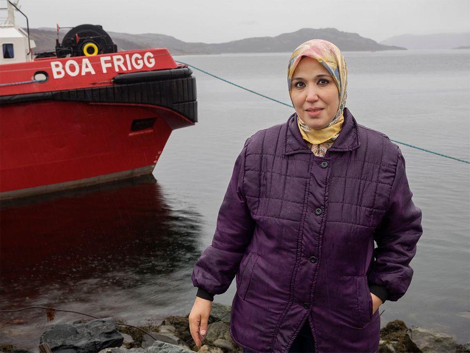 Portrait of Alsaid's wife standing in the port at Kirkenes. Kirkenes, Norway. October 2015.