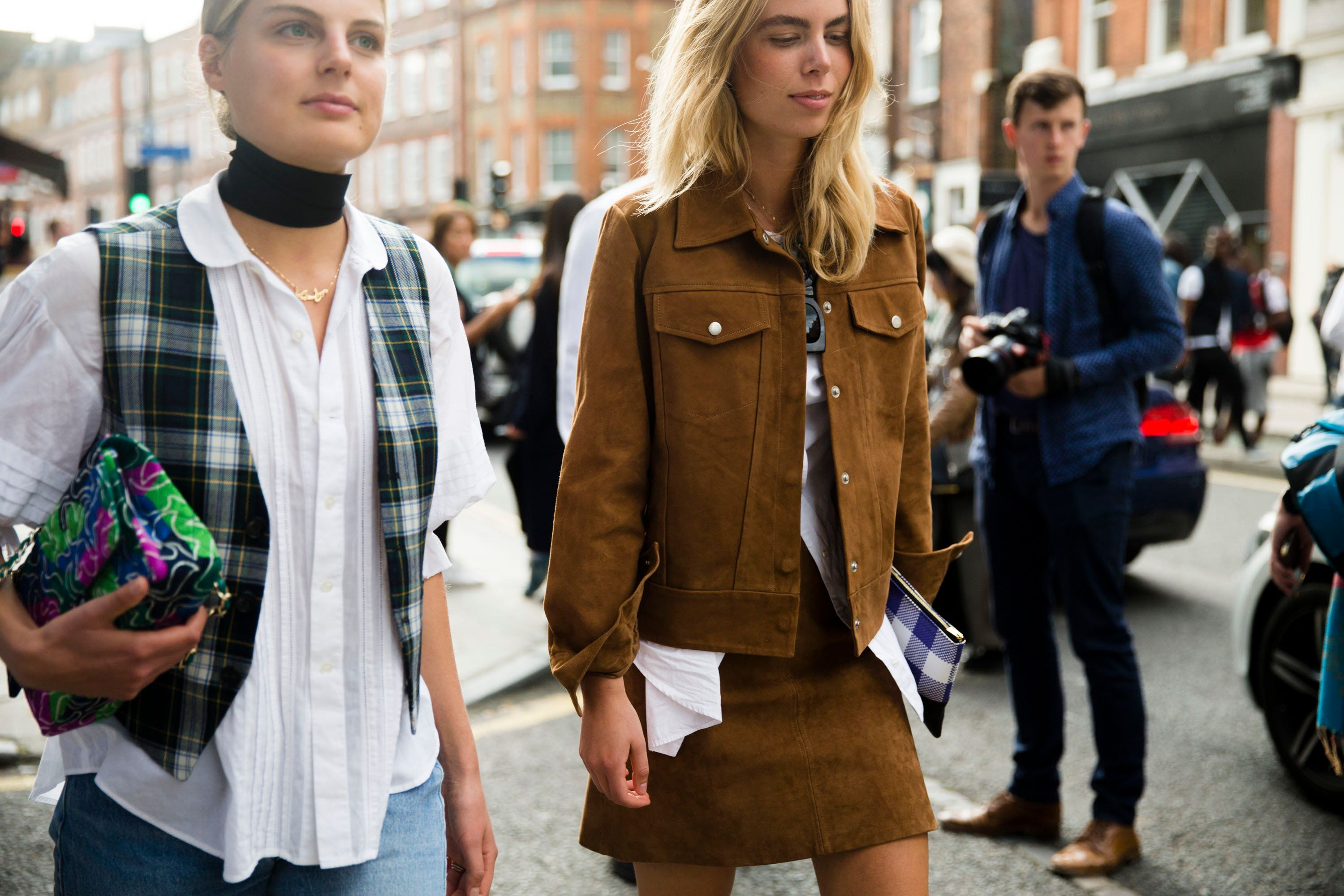 LONDON, ENGLAND - SEPTEMBER 19:  Claire Beermann and Laura Maria Wulff of Wood Wood enter the J.W. Anderson show during London Fashion Week Spring Summer 2016 at Yeomanry house on September 19, 2015 in London, England. Claire wears a Comme des Garcons top, Each x Other plaid vest, and a Rianna and Nina purse. Laura wears a structured suede jacket with pockets and skirt. (Photo by Melodie Jeng/Getty Images)