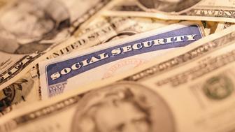 Social Security Card Among Dollar Bills
