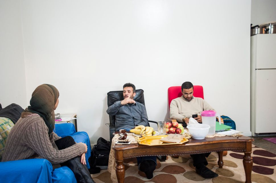 Mohamed Darbi, left, has had trouble acclimating to life in New Jersey. Mahmoud Mahmoud, right, is the Jersey City Director o