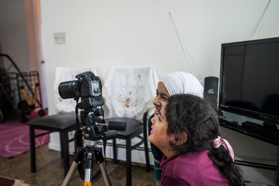 Hajar Darbi, in the foreground, and Nabiha Darbi, behind her, mesmerized by the camera.