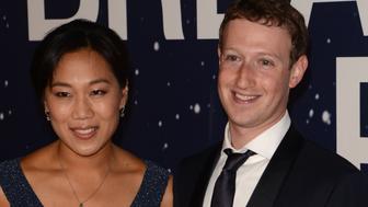 MOUNTAIN VIEW, CA - NOVEMBER 09:  Priscilla Chan and Mark Zuckerberg attend the 2014 Breakthrough Prize Awards at NASA AMES Research Center on November 9, 2014 in Mountain View, California.  (Photo by C Flanigan/FilmMagic)