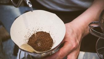 Barista pouring water on coffee ground with filter, Hand drip making coffee