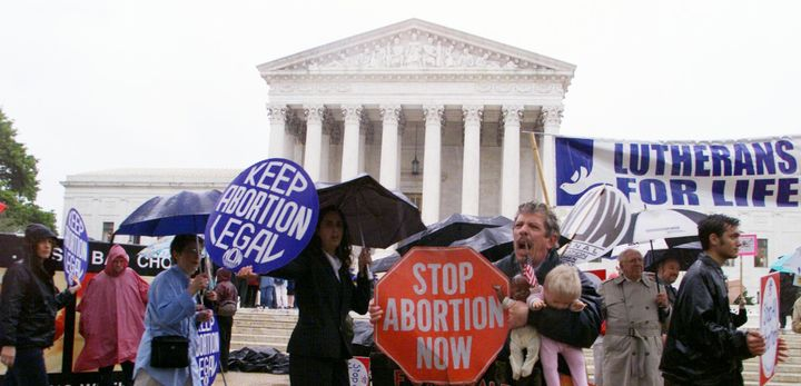 UNITED STATES - APRIL 25: Pro-choice and anti-abortion activists demonstrate in front of the Supreme Court building as argume