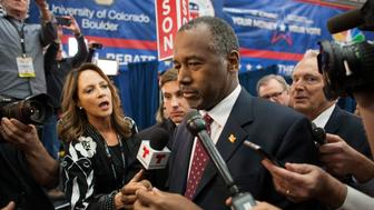 Ben Carson, 2016 Republican presidential candidate, center, speaks to the media in the spin room after the Republican presidential debate at the University of Colorado in Boulder, Colorado, U.S., on Wednesday, Oct. 28, 2015. Three Republican senators running for president have come out swinging against a bipartisan budget deal as an emblem of everything that's wrong in Washington, making it a likely pinata in the party's third debate. Photographer: Matthew Staver/Bloomberg via Getty Images