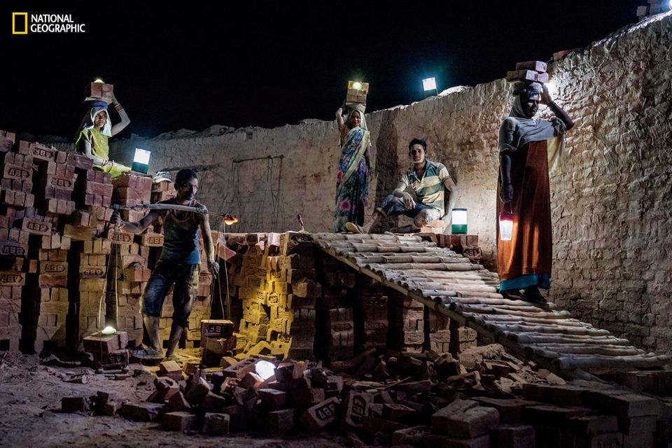 At a brick kiln in India's rural state of Uttar Pradesh, workers use solar lanterns to illuminate their