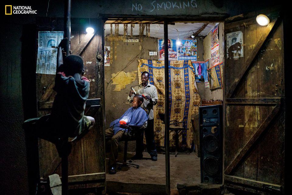 Electricity is a rare luxury in Uganda. Denis Okiror, 30, began using solar lights at his barbershop...