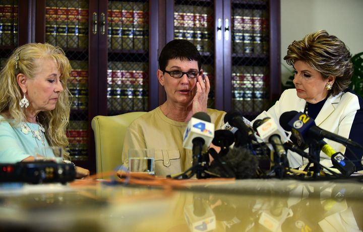 Beth Ferrier reacts while speaking seated between attorney Gloria Allred and Rebecca Lynn Neal (L) on July 13, 2015 in Los An