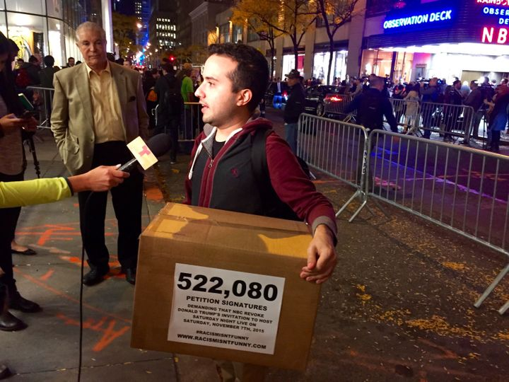 """Activist Juan Escalante prepares to deliver petitions bearing 522,080 signatures asking NBCUniversal to rescind its invitation to bring on Donald Trump as a guest host this week on """"Saturday Night Live."""""""