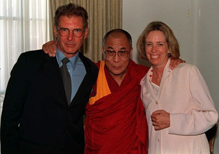 Harrison Ford and Melissa Mathison pose with the Dalai Lama in 1996.