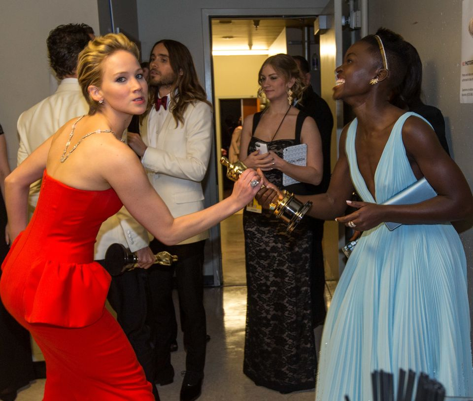 HOLLYWOOD, CA - MARCH 02:  Actresses Jennifer Lawrence (L) and Lupita Nyong'o backstage during the Oscars held at Dolby Theat