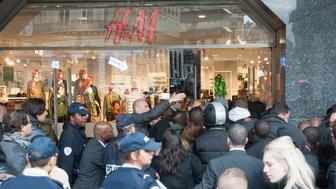 PARIS, FRANCE - NOVEMBER 05:  Shutters are lowered and police arrive on the scene due to arguments breaking out during the H&M Haussman Store Opening At 8 am For the Launch of The BALMAIN x H&M Collection in Paris at H&M Boulevard Haussmann on November 5, 2015 in Paris, France.  (Photo by Kay-Paris Fernandes/Getty Images)