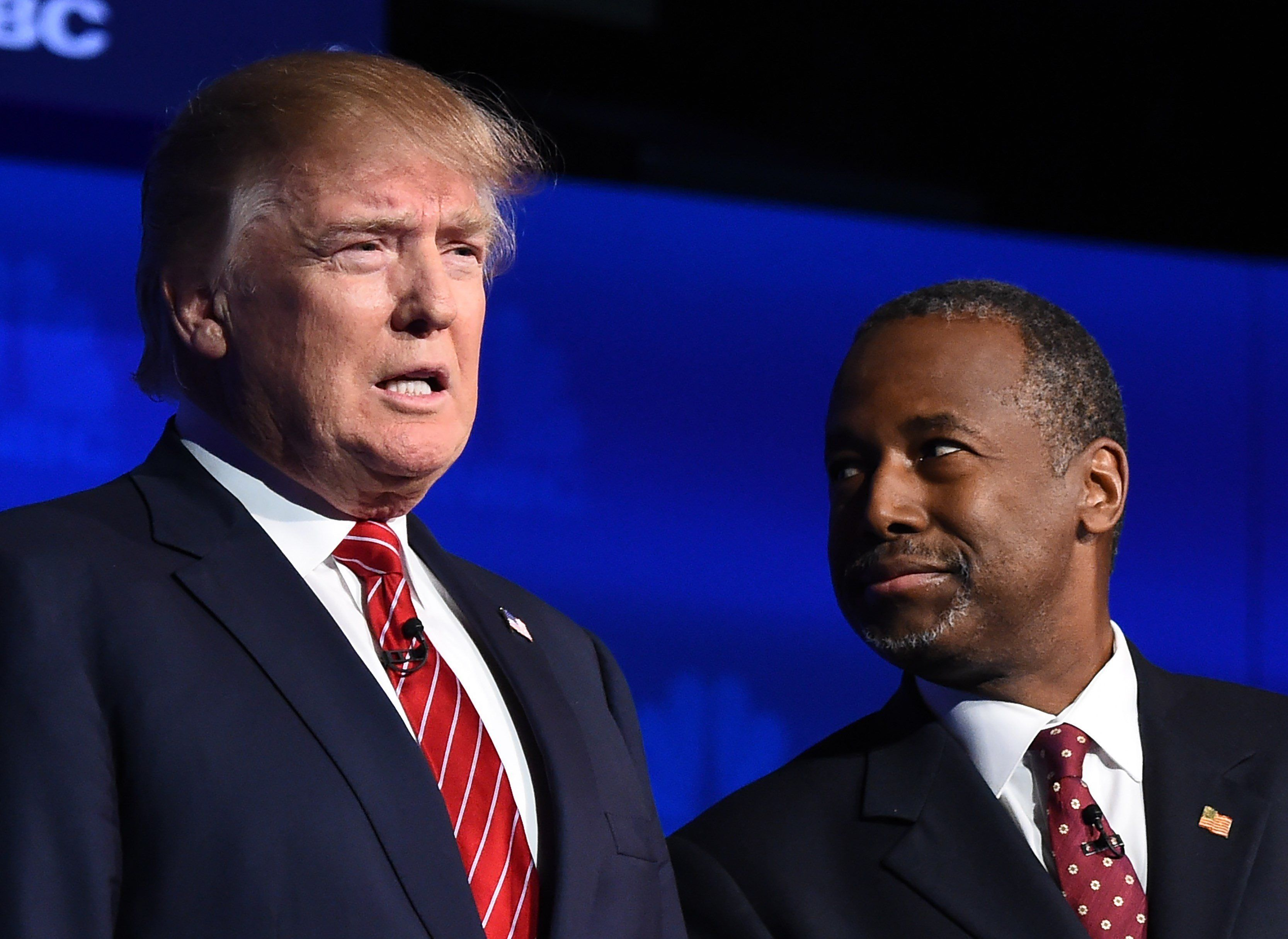 Republican presidential hopefuls Donald Trump and Ben Carson at the third Republican Presidential Debate, October 28, 2015 at the Coors Event Center at the University of Colorado in Boulder, Colorado.  AFP PHOTO / ROBYN BECK        (Photo credit should read ROBYN BECK/AFP/Getty Images)
