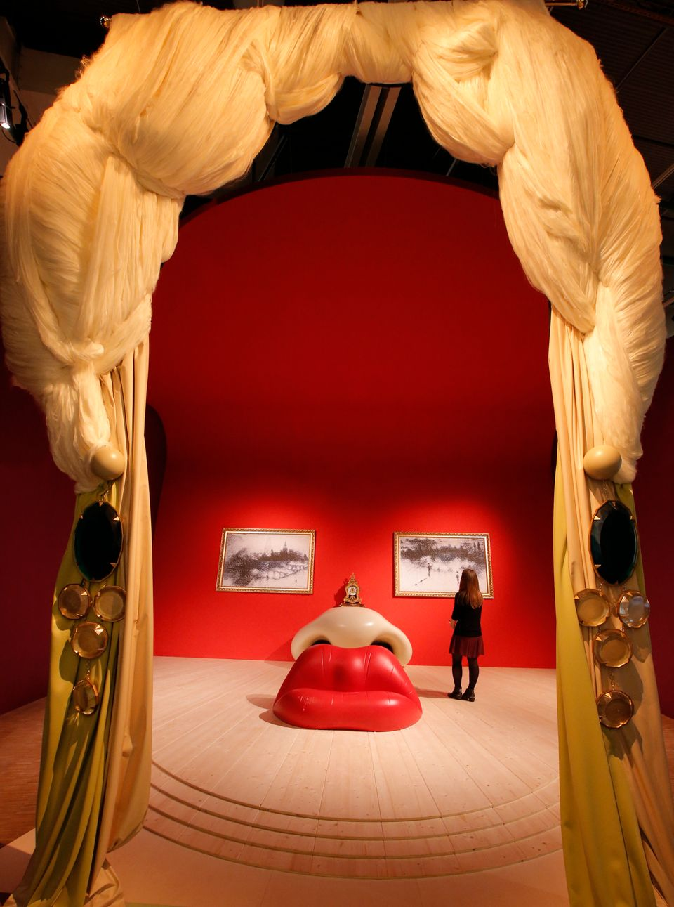 In this photo taken Monday, Nov. 19, 2012, a visitor stands in the 'Mae West, 1934' room by Spanish artist Salvador Dali (190