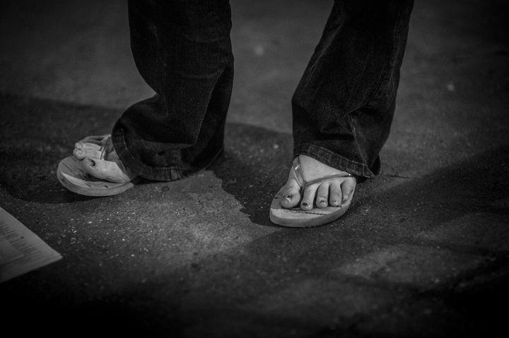 A homeless woman wears flip-flops on October 27, 2014 in London, England.