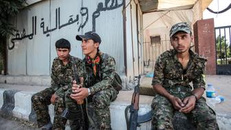 TAL ABYAD, SYRIA - JUNE 19: (TURKEY OUT) (TURKEY OUT) Kurdish People's Protection Units, or YPG fighters rest in Tal Abyad, Syria. June 19, 2015. Kurdish fighters with the YPG took full control of Tal Abyad, dealing a major blow to the Islamic State group's ability to wage war in Syria. Mopping up operations have started to make the town safe for the return of residents from Turkey, after more than a year of Islamic State militants holding control of the town. (Photo by Ahmet Sik/Getty Images)